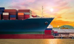 Container ship in import,export port at the harbor with beautiful twilight sky